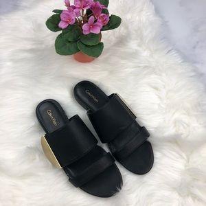 Calvin Klein black leather sandals/gold detail